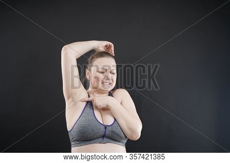 Unhappy Woman Shows Her Unshaved Armpit. Plus Size Middle Age Woman Is Not Happy With Hair In Her Ar