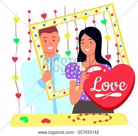 Smiling Man And Woman Standing Together, People With Photozone Accessories. Lovers Posing For Photos