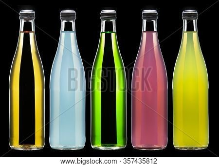 Five Bottles Of Carbonated Lemonade In Various Colors