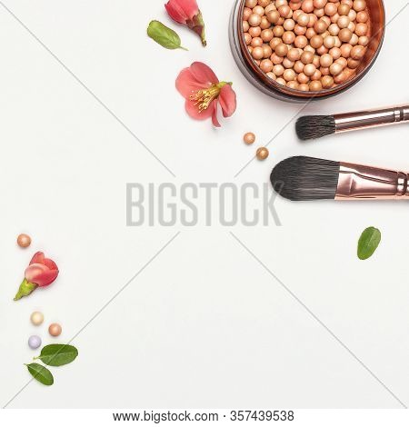 Professional Makeup Brushes Powder Blush Balls With Pink Spring Flowers On Light Background Flat Lay