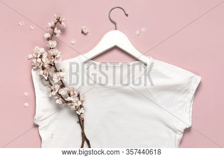 Spring Sale Concept. White Blank Women's T-shirt Spring Twigs Of Flowers White Wooden Hangers On Pin