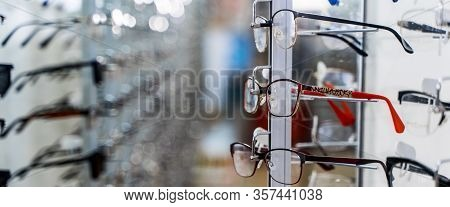 Eye Glasses In A Store. Eyeglasses Shop. Stand With Glasses In The Store Of Optics.