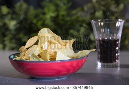 Tempting Potato Chips On A Ceramic Bowl