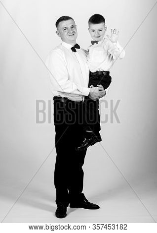 Relations Of Dad And Son. Gentleman Upbringing. Father Carry Hug Son Formal Clothes Outfit. Grow Up