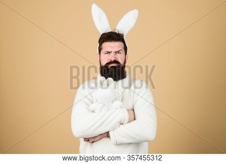Guy Bearded Hipster Weird Bunny With Long White Ears Beige Background. Easter Rabbit. Man Wearing Ra
