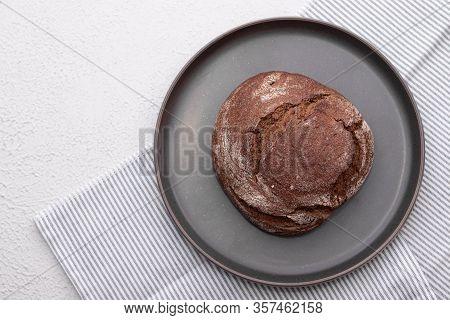 Black Bread. Homemade Cake. Black Bread Is Sprinkled With Flour. Freshly Baked Homemade Artisan Rye