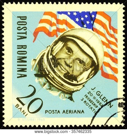 Moscow, Russia - March 23, 2020: Stamp Printed In Romania Shows Portrait Of American Astronaut John