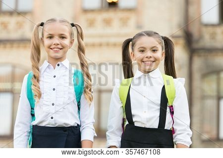 Cute Schoolgirls With Long Ponytails Looking Charming. Ending Of School Year. Lucky To Meet Each Oth