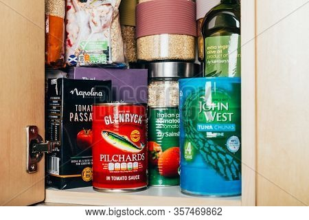 London, Uk: March 18, 2020: Cupboard Shelves Fool Of Food Provision, Such As Pasta, Rice, Porridge,