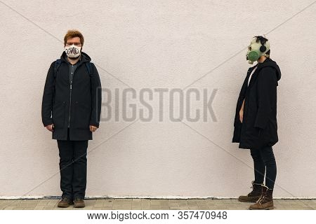 Banter Concept Picture Of Two Man Portraits In Medicine Mask And Gas Mask Hipster Style Cloth In Con