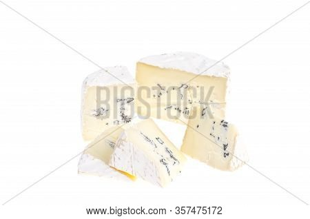 Camembert Cheese, Cut Into Pieces, On White Background.