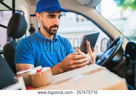 Delivery Man Driver Using Digital Tablet.