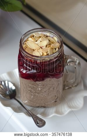 Chia Pudding With Cherry Jam And Almond Petals