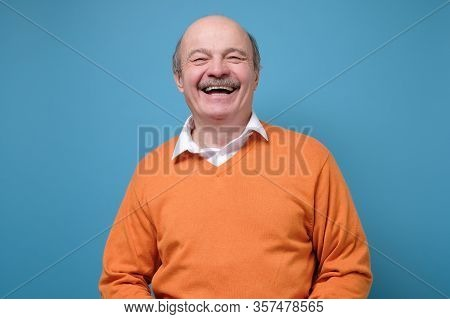 Laughing Senior Handsome Man Having Great Mood Feeling Positive.