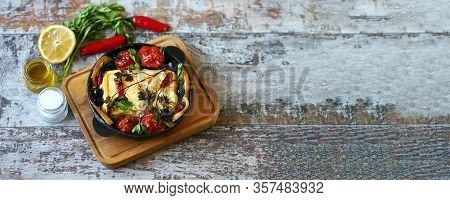 Selective Focus. A Pan With Baked Feta, Spices And Vegetables. Keto Diet. Baked Feta Cheese. Healthy