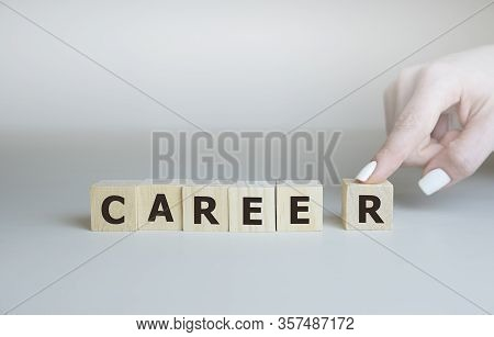 Career Adviser Assembling The Word Career With Six Wooden Cubes In A Conceptual Image Of Personal Gu