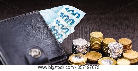 Wallet Full Of Money From Brazil, One Thousand Reais On One Hundred Reais Bank Notes. With Coins In