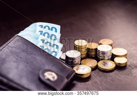 Plenty Of Brazilian Money, Banknotes, Notes And Many Coins In An Isolated Wallet. Brazil Money Fortu