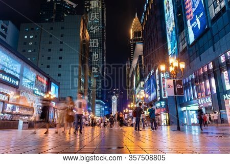 Chongqing, China - Aug 31, 2019: People At The Jiefangbei Pedestrian Street In Chongqing At Night. I