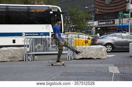 New York, New York/usa - May 7, 2018: Guy Uses His Skate Board On Union Square And East 14th Street