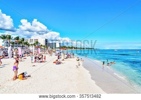 Playa Del Carmen, Mexico - Dec. 26, 2019: Crowded Beach Filled With People Playing And Sunbathing At