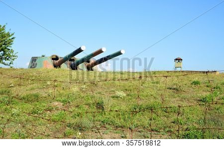 Sevastopol, Crimea - July, 2019: Trunks Of Guns Of The Artillery Tower Mb-3-12-fm Behind Barbed Wire