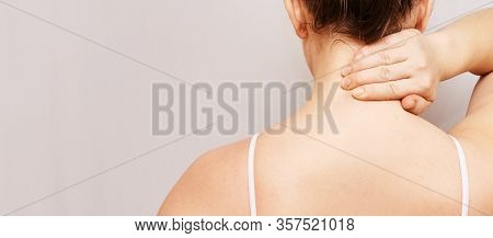Girl Hold Hand Near Neck. Back View. Female Head And Shoulder. Home Self Massage. Young Woman Arm. M