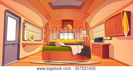 Camping Trailer Car Interior With Unmade Bed, Desk With Laptop, Shelf With Books, Cacti Plants And J
