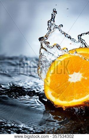 orange fruit slice in water splash stream