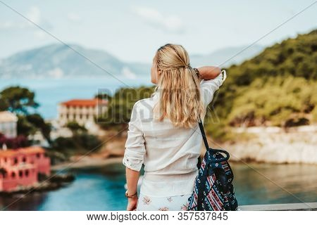 Tourist Female In Greek Small Vivid Colored Assos Village In Morning. Kefalonia, Greece. Sommer Vaca