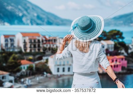 Tourist Female Admire Colored Assos Town On Kefalonia Island, Greece. Sommer Vacation Holiday Vintag