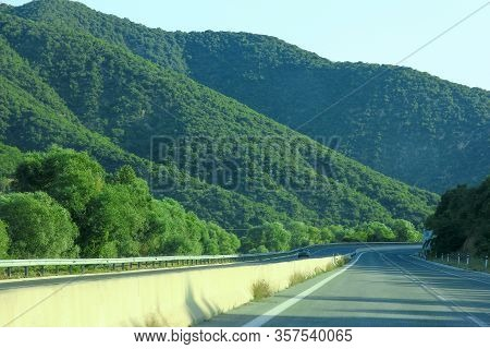 A Road Near The Mountains On Summer