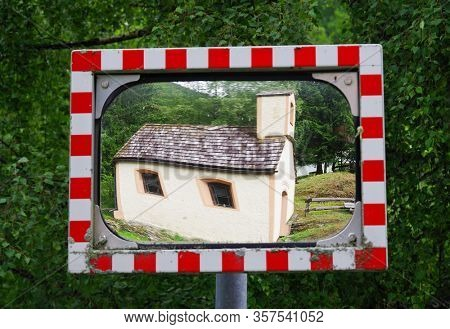 Spherical road mirror in the outdoors