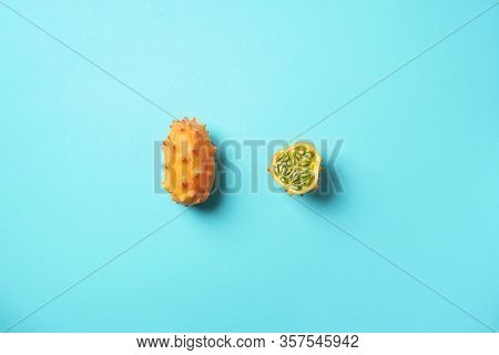 Kiwano Or African Horned Melon On Blue Background. Top View. Cutted Hedged Gourd, African Horned Cuc