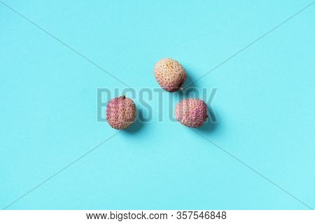 Lychee Fruits On Blue Background. Top View. Copy Space. Exotic Litchi, Lichee Fruits. Tropical Food
