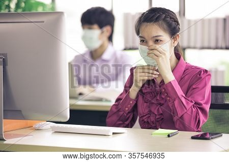 Man And Woman Businesspeople Working Together In Office While Wearing Surgical Hygienic Mask For Pro