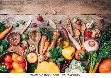 Fresh Ingredients For Healthy Cooking Or Salad Making On Wooden Background. Top View. Copy Space. Di