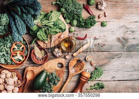 Orgnic Healthy Vegan Food Cooking Ingredients. Top View. Copy Space. Green Vegetables, Seeds, Avocad