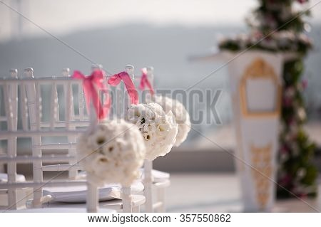 Wedding Day. Beautiful Wedding Setting With Sunny Day. Beautiful Wedding Flower Decorations. Wedding