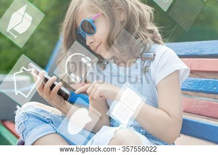 School Child Holding A Mobile Smartphone. Kid Studying Online. Touch Screen Interface. Digital Learn