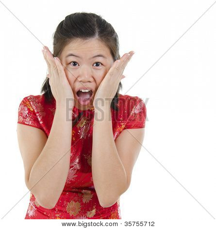 Oriental Asian female with cheongsam get shock over white background