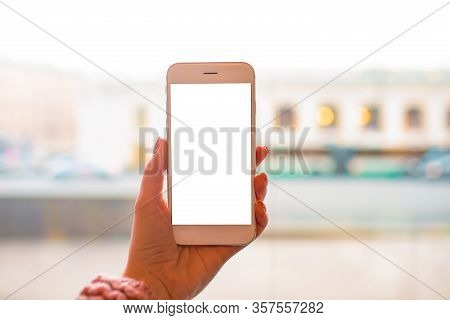 Close Up Woman Blogger Holding Modern White Mobile Phone With Empty Copy Space Screen Background For