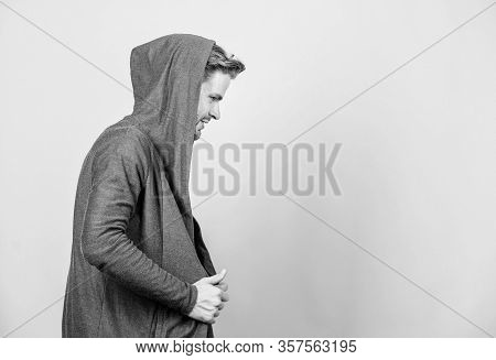 Hip And Stylish. Copy Space. Man In Trendy Hooded Jacket. Perfect Look Of Muscular Man. Male Fashion