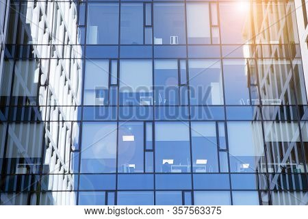 View Of Office Building  With Sunrise, Reflection And Perspective. Bright Outlook For Business. Mode