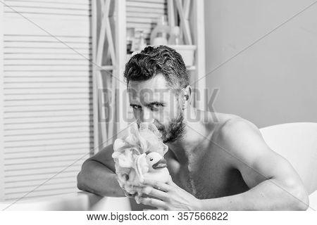 Macho Naked In Bathtub. Funny Duckling. Playful Mood. Macho Enjoy Bath. Sexy Man In Bathroom. Sex An