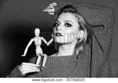 Expressive Look. Fashion Model. Girl Smoky Eyes Makeup Face Carry Wooden Mannequin On Shoulder. Woma