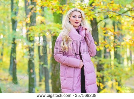 Jackets Everyone Should Have. Girl Fashionable Blonde Walk In Park. Best Puffer Coats To Buy. How To
