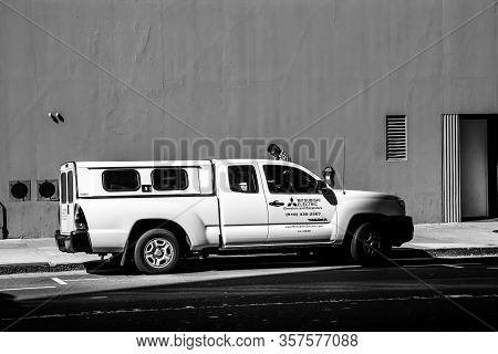 San Francisco, Ca - Sept 20, 2010: White Toyota Tacoma Car With The Mitsubishi Electric Elevators An