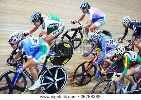 MOSCOW - AUGUST 19: Female cyclists ride fast at UCI juniors track world championships on August 19, 2011 in Moscow, Russia.