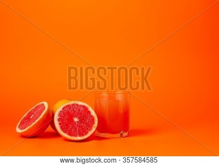 Grapefruit Juice And Ripe Grapefruits. Grapefruit Juice Glass. Isolated. Whole And Cut Fruits On An